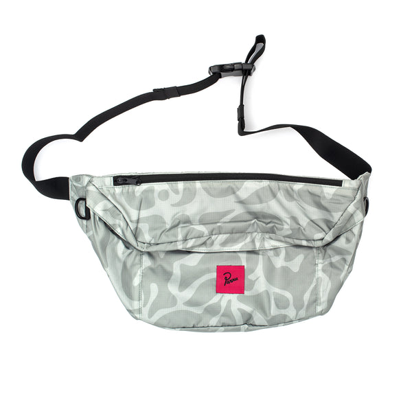 Extra oversized waist bag measuring 19.69 x 9.45 inches Made from a water resistant allover printed ripstop nylon fabric 3 zippered compartments, 2 at the front and 1 at the backside 2 mesh inner compartments Adjustable waist strap with buckle closure Pink woven label at front Product code: 43700  bird camo waist pack bag side sac banane off the hook oth streetwear boutique by parra