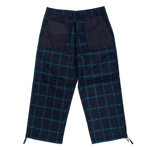 The Check Cropped Trackpants feature two front patch pockets, a rear pocket with button closure, adjustable drawstring waist and cuffs and a hand-machined maharishi embroidery over the rear pocket. 8071 off the hook oth streetwear boutique canada montreal navy glory