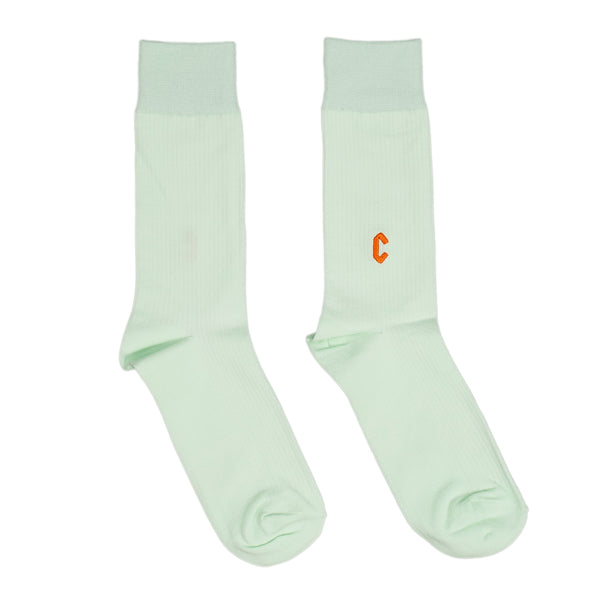 """The Chrystie Casual Socks in mint are a lightweight pair of socks for every day wear. Contrasting """"C"""" logo embroidery adds low-key branding.  Lightweight 59% Cotton / 26% Acrylic / 11% Nylon / 2% Spandex / 2% Polyester  One Size fits most Made in Korea streetwear skate boutique montreal canada off the hook oth"""