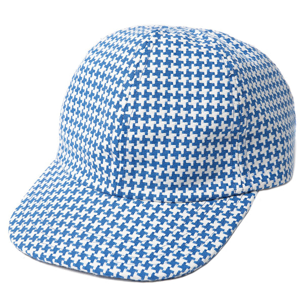This 6-panel cap is handmade in New York with vintage blue pied de poule fabric. The white leather strap back closure completes its unique look.  Product code: CHRYSTIESU1914 Falcon Bowse Hat Blue off the hook oth streetwear boutique canada montreal