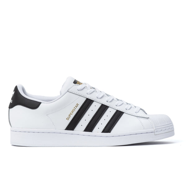 Buy adidas Superstar White / Black at Off the Hook. Originally made for basketball courts in the '70s. Celebrated by hip hop royalty in the '80s. Product code: EG4958 Now at OTH. classic shelltoe superstar white black gold foundation off the hook oth streetwear sneakers shoes boutique canada montreal