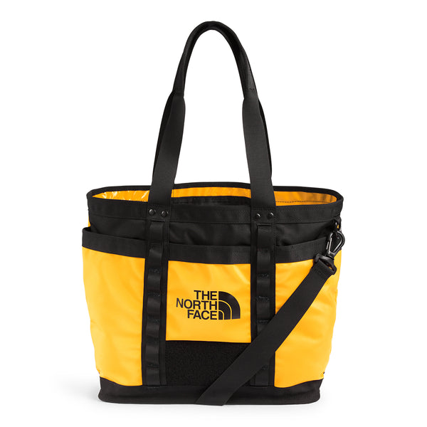 The North Face NF0A3KZU Explore Utility Tote Gold / Black front disponible à off the hook montreal