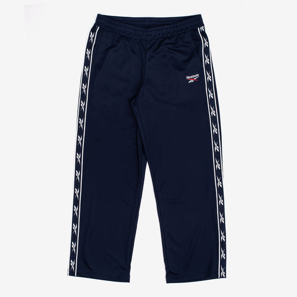 e Reebok Classics Vector Tape Pants in Navy feature a repeating Vector logo tape and and wide leg fit, for a strong retro aesthetic. Reflective details garner just the right amount of attention.   This product is displayed in Women's sizing 100% polyester doubleknit interlock Product code: FT8223  off the hook oth streetwear boutique canada montreal quebec