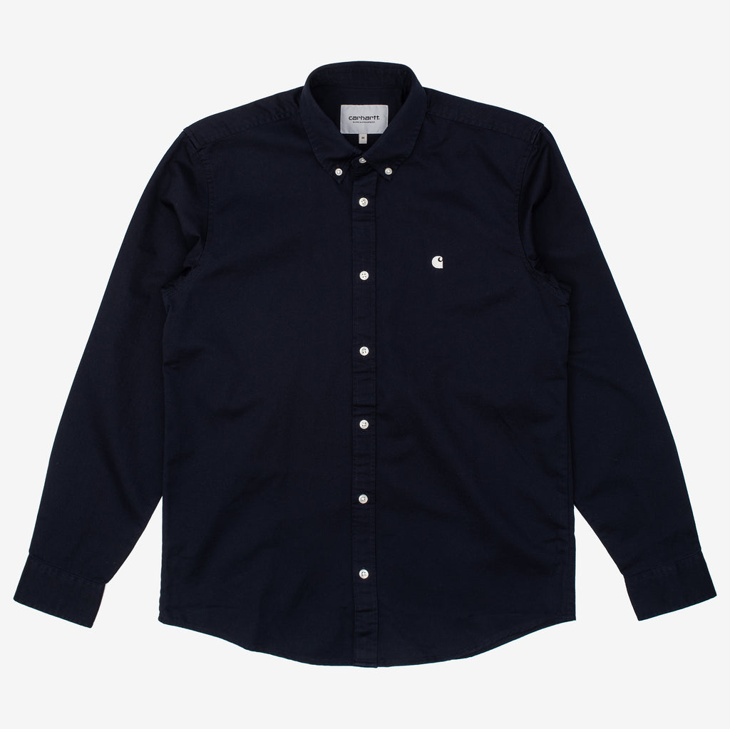 The Long Sleeve Madison Shirt is a classic button down created in a midweight cotton twill, with a curved hem and contrast button detailing. Carhartt logo embroidery   100% Cotton Twill, 6.5 oz Product code: I023339.1C90 off the hook oth streetwear workwear boutique canada montreal