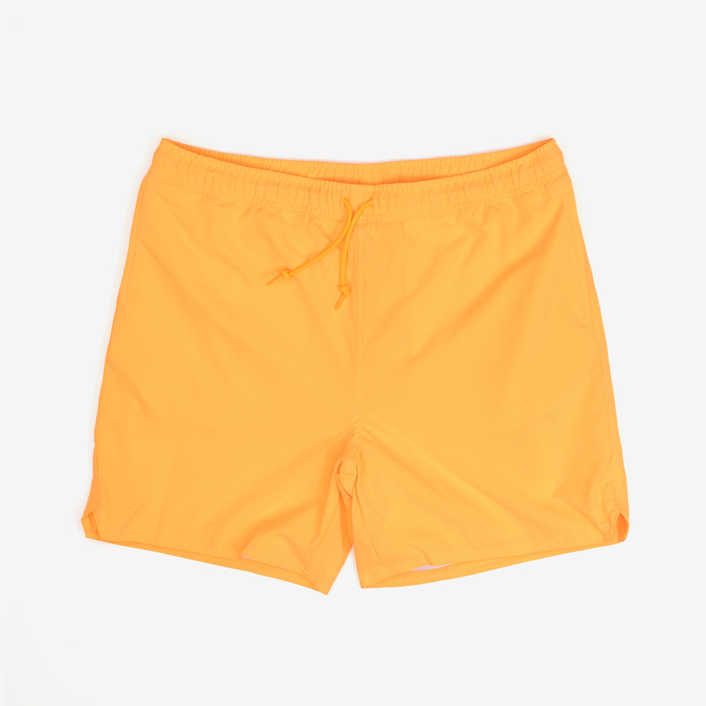 "The Aran Swim Trunk in Pop Orange are lined trunks constructed from lightweight, fast-drying polyester. Features a summery take on Carhartt 'C' logo as a rubberized patch. They boast two side pockets, and a zip pocket on the back adds utility with it's interior key holder.  100% Polyester, 3 oz 6"" inseam Water Repellent Product Code : I027640.09G.00  off the hook oth streetwear boutique canada montreal"