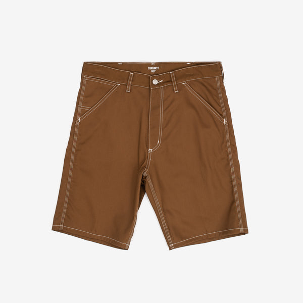 "The Penrod Short in Hamilton Brown are durable, regular fit twill shorts with a longer inseam, keeping in line with the brand's workwear aesthetic. The contrast stitching and Carhartt WIP logo patch complete the look. 100% Cotton 'Griffith' Twill, 9 oz 9.5"" inseam Product code: I027949.HZ.01 off the hook oth streetwear boutique canada montreal"