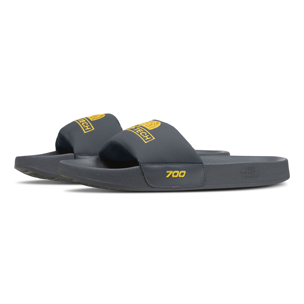 The North Face NF0A4T2J Steep Tech Nuptse Slide Grey / Yellow Side disponible à off the hook montreal