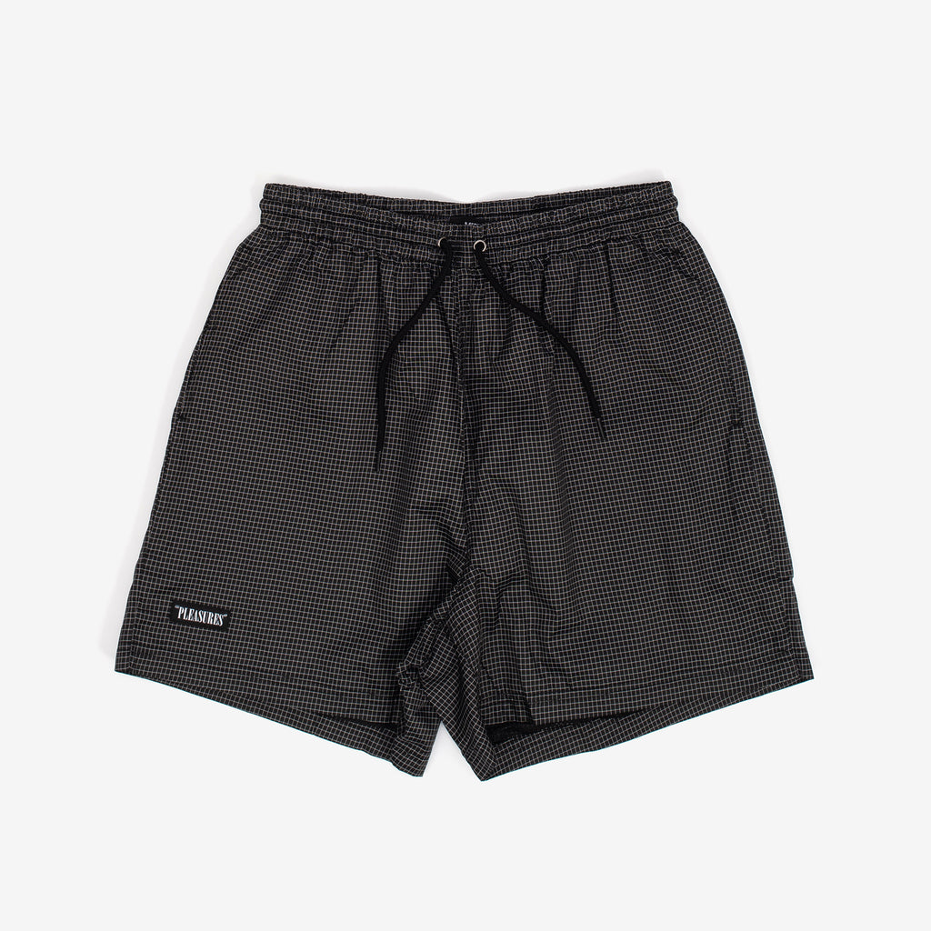 The Brick Active Shorts in Black from Pleasures feature an allover grid print, 2 front pockets, and one back pocket. A small embroidered logo patch adds subtle branding. 65% Nylon, 35% Polyester Mesh Lining Elasticated Drawstring Waist Product code: P20SU016 off the hook oth streetwear boutique canada montreal