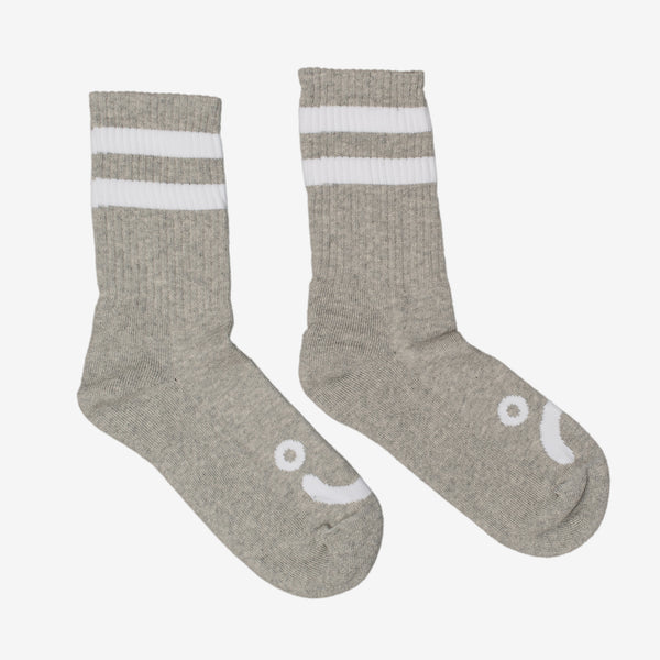 The Happy Sad Socks in Grey from Polar Skate Co feature a happy face on one foot, and a sad face on the other. This pair of socks may suggest you are in touch with your feelings. 85% Cotton / 10% Polyester / 5% Spandex Crew Length Made in Poland Product code: POLSP20059  off the hook oth streetwear boutique canada montreal