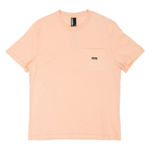 The Small OG Logo Patch Pocket T-shirt in orange comes in a cut and sew 180 GSM cotton construction, with subtle patch branding on the left chest pocket. The over-dye treatment gives this tee a vintage vibe, with the durability of a brand new garment.