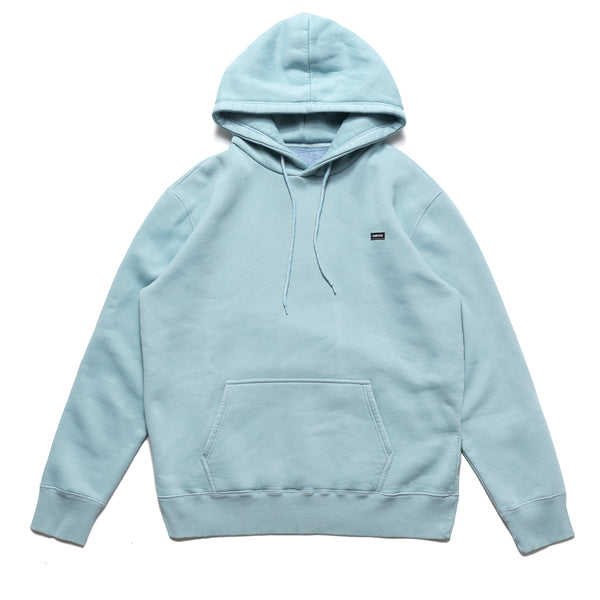 The Small Patch Logo Hoodie in stone blue from Chrystie NYC comes in a cut and sew 320 GSM fleece construction, with subtle patch branding on the left breast. The over-dye treatment gives this hoodie a vintage vibe, with the durability of a brand new garment. Now at Off The Hook.