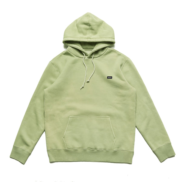 The Small Patch Logo Hoodie in weed green from Chrystie NYC comes in a cut and sew 320 GSM fleece construction, with a subtle patch branding on the left breast. The over-dye treatment gives this hoodie a vintage vibe, with the durability of a brand new garment. Now at Off The Hook.