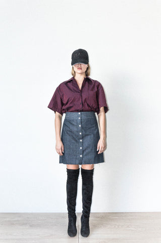 A LINE SKIRT WITH 7 BUTTON SNAP CLOSURE IN SELVEDGE DENIM