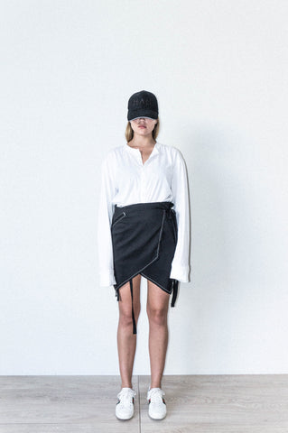 ASYMETRIC WRAP SKIRT IN BLACK WOOL CREPE