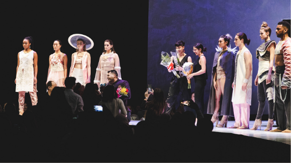 Models and students onstage at Lunar Gala receiving flowers and praise from the audience