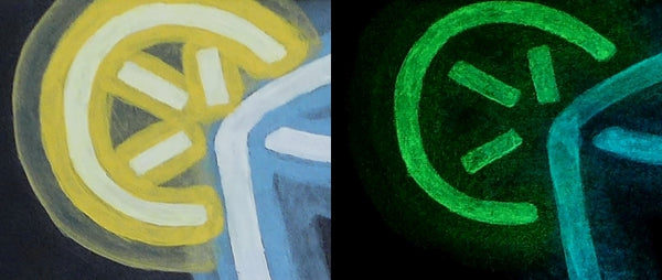 fluorescent acrylic painting of a lemon wedge in both daytime and at night