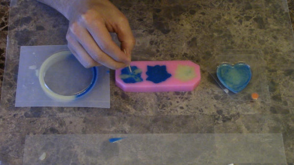 popping the bubbles in glow epoxy