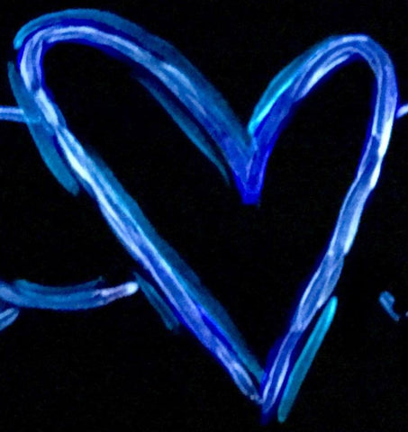 Glow in the dark heart as an example of raised edges in a brush stroke