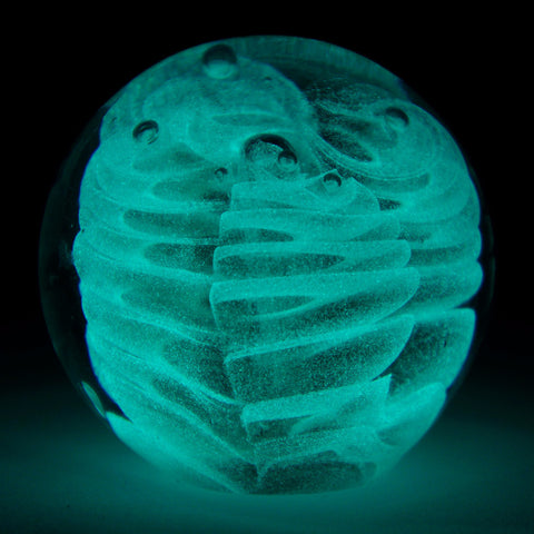 glowing teal columns paperweight