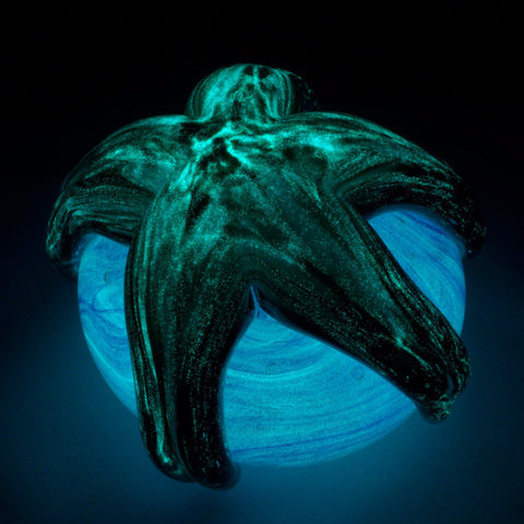 glowing glass starfish paperweight