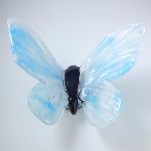 daytime sky blue glass butterfly