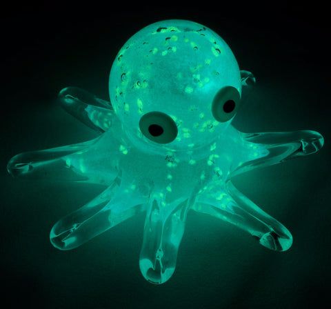 blue green glowing white glass octopus