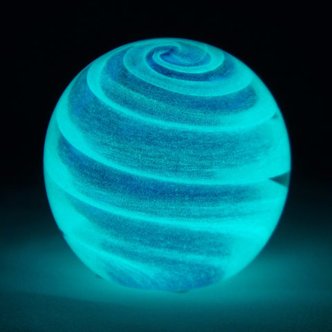 glowing blue swirl paperweight