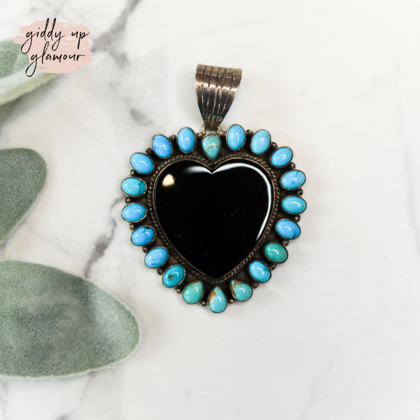 dan dodson heart onyx and turquoise sterling silver pendant navajo zuni nations indian handmade handcrafted native american heritage style turquoise and co