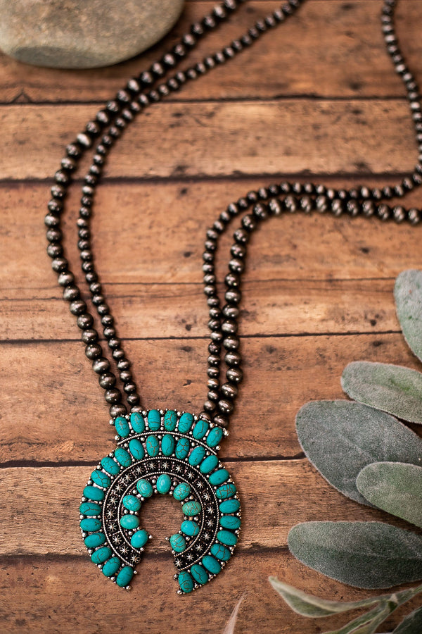 Oval Pendant Necklace with Turquoise Beading