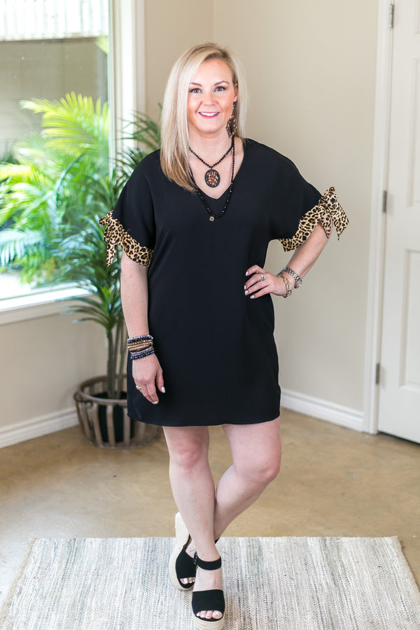 Chic Perspective V Neck Dress with Leopard Sleeve Ties in Black