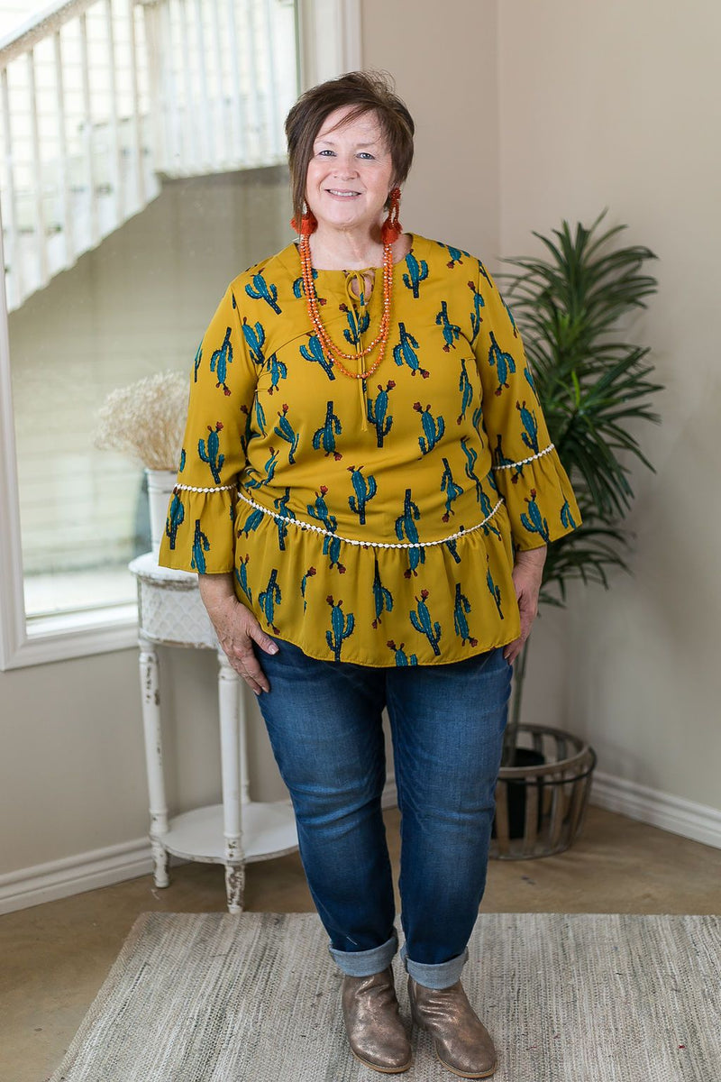 Back In Town Cactus Peplum Tunic Top in Mustard bell sleeves lace trim teal cactus tie neck