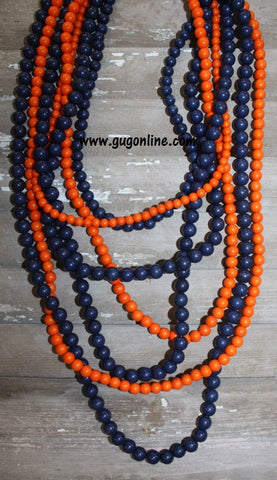 7 Strands of Orange and Navy Beaded Necklace