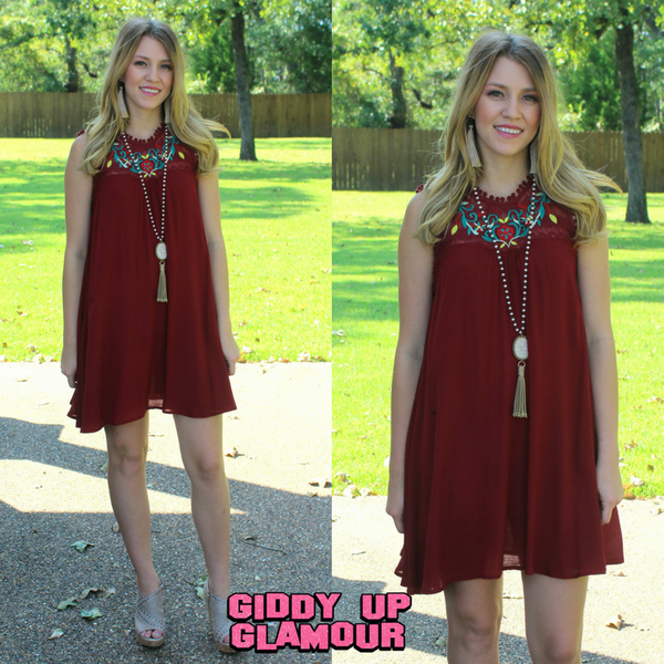 Distinctively Darling Sleeveless Dress with Floral Embroidery and Pom Trim in Maroon