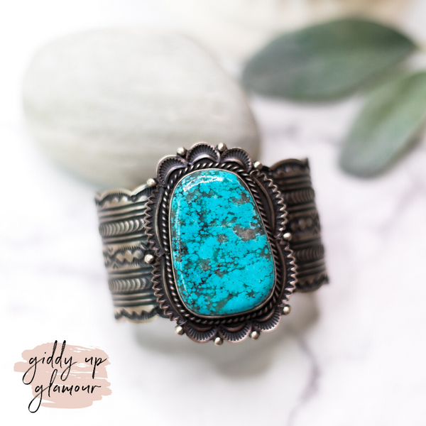 harold joe sterling silver handmade handcrafted indian native american zuni navajo nations eched cuff bracelet with large kingman turquoise stone at center