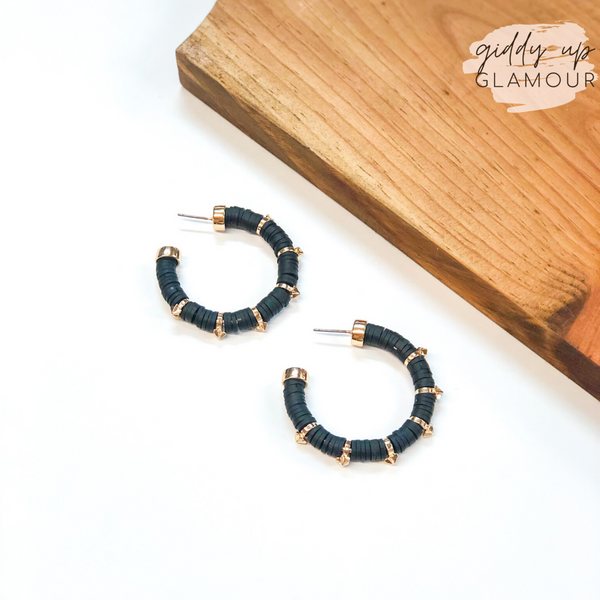Stars Aligned Disk Bead Hoop Earrings with Gold Stars in Black