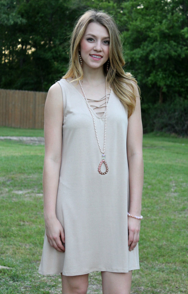 Sure to Charm Sleeveless Tunic Dress with Criss Cross Front in Khaki
