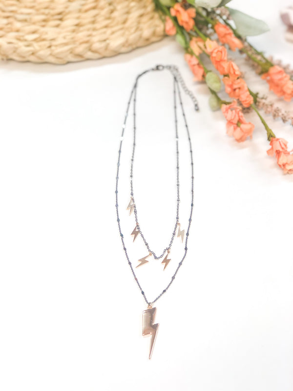 Strike Me Double Strand Necklace with Gold Lightning Bolts in Gunmetal