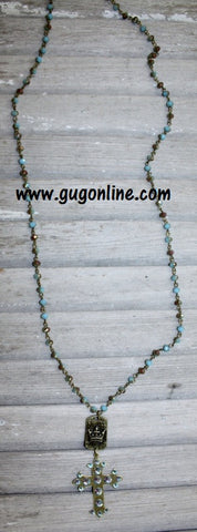 Aqua Crystals on Cross and Crown Dangle on Aqua and Topaz Necklace