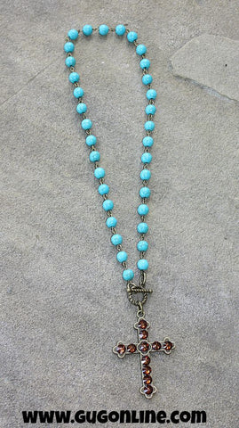 Pink Panache Turquoise Bead Necklace with Bronze Cross Covered in Brown Crystals