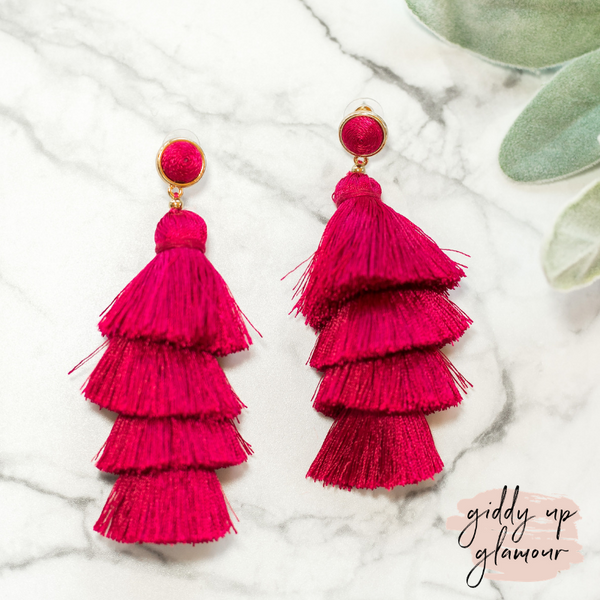 fun and flirty fast fashion long layered fringed tassel earrings with treaded top in raspberry fuschia pink on post back with gold accents