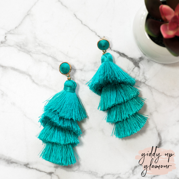 fun and flirty fast fashion long layered fringed tassel earrings with treaded top in turquoise blue on post back with gold accents