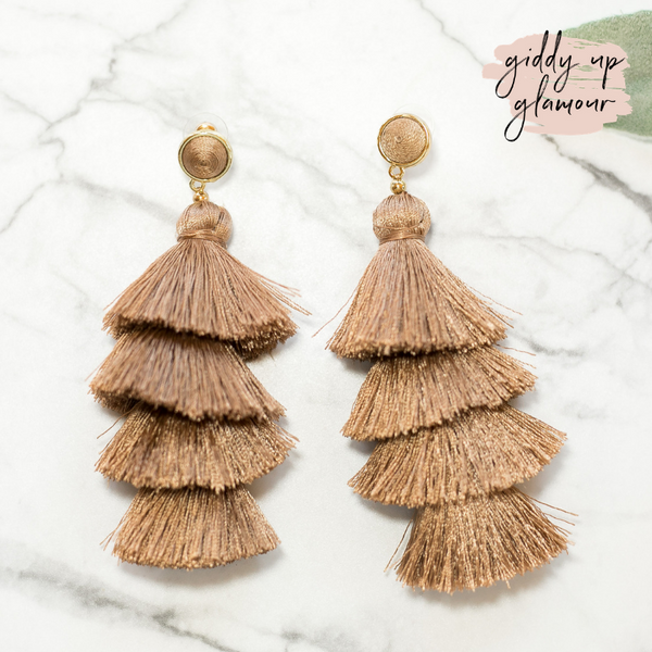 fun and flirty fast fashion long layered fringed tassel earrings with treaded top in mocha brown tan taupe on post back with gold accents