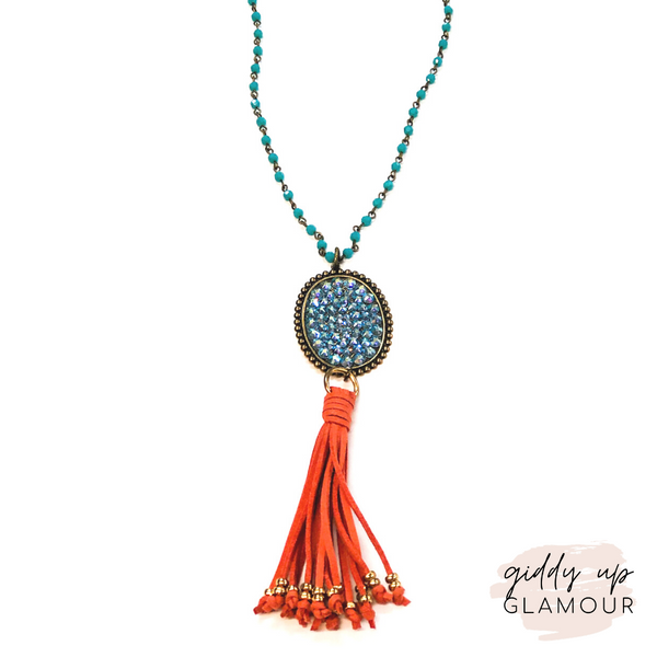 Pink Panache Long Turquoise Crystal Necklace with Oval Covered in Crystals and Coral Tassel | ONLY 1 LEFT