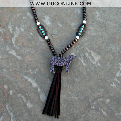 Long Copper and Turquoise Bead Necklace with Tassel and Leopard Print Show Cattle