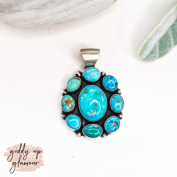 augustine largo handmade handcrafted genuine sterling silver flower cluster pendant kingman turqouise kingman arizona zuni navajo native american heritage style turquoise and co