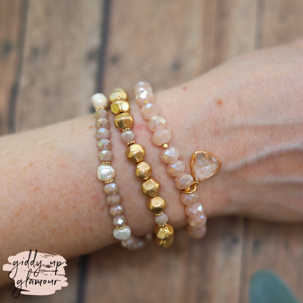 Set of Three Bracelets in Gold and Blush Pink with Clear Crystal Charm