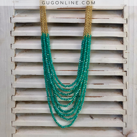 Nine Crystal Stands on Gold Chains in Turquoise