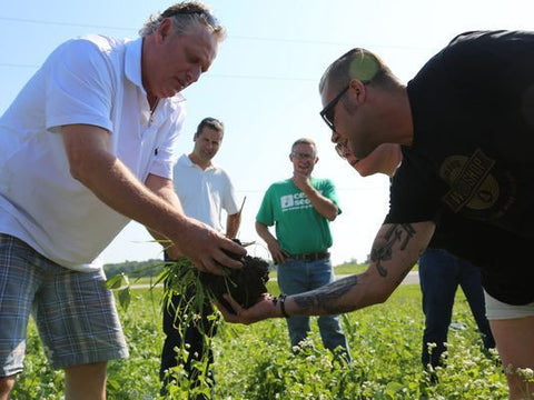 Jeff Rasawehr, left, shows Union Joints Executive Chef Aaron Cozadd what healthy soil looks like on one of his fields near Celina, Ohio. The pair have teamed up with Gino Baratta, a third-generation butcher at Fairway Packing, to produce Cover Crop Ranch meat. (Photo: Mark Kurlyandchik, Detroit Free Pres