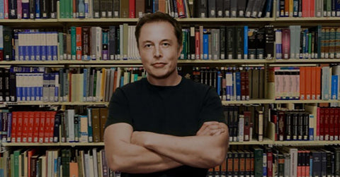Elon Musk in front of Books