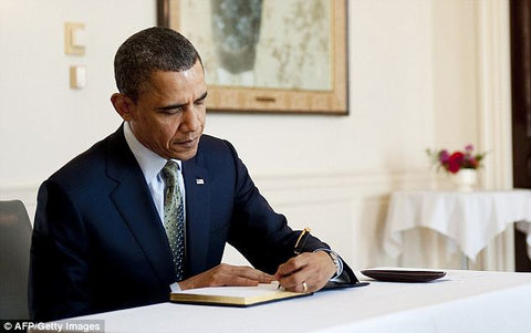 President Obama signing a book